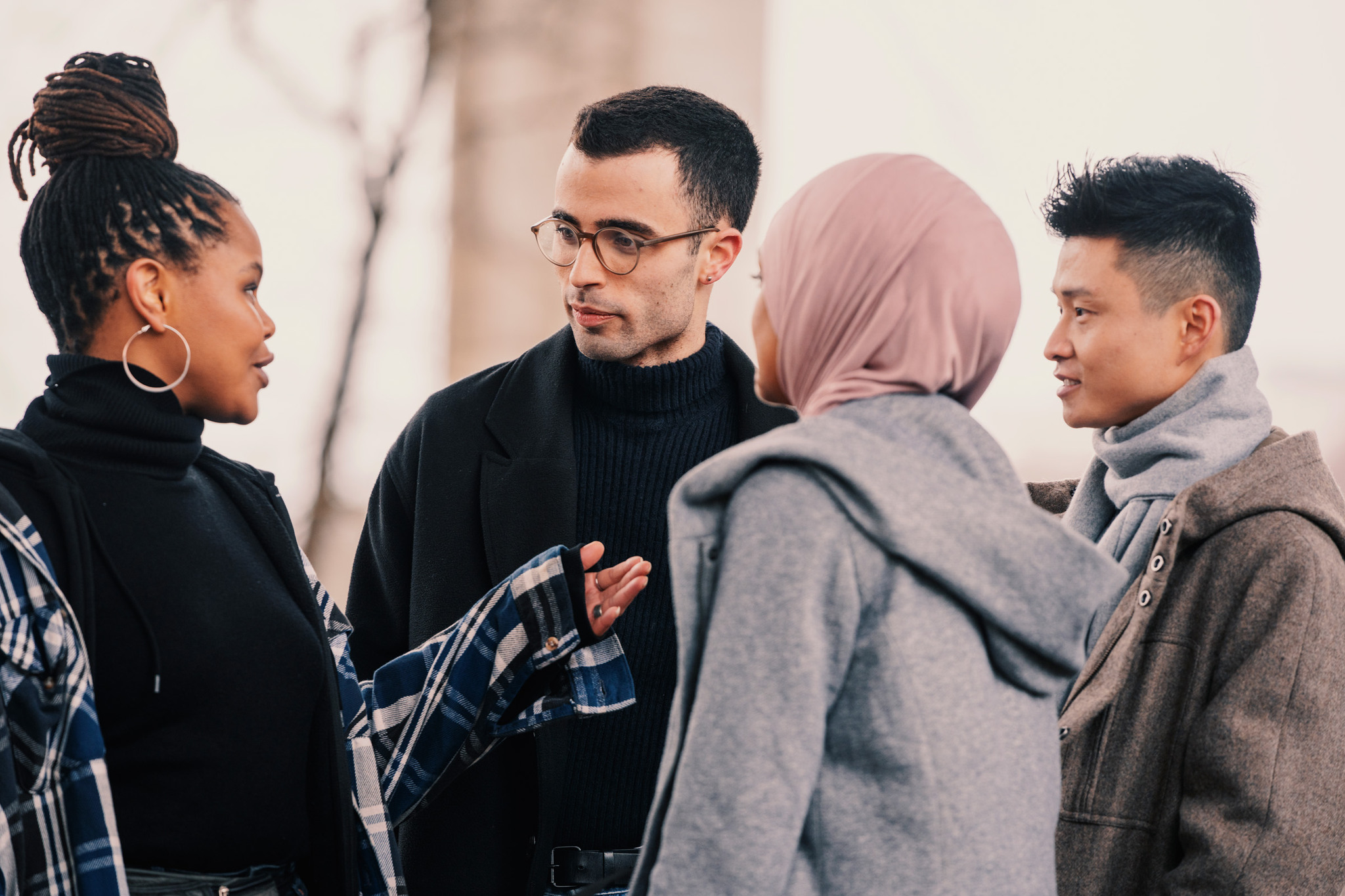 4 international students talking to each other in Sweden