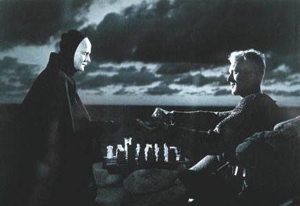 A still from the Seventh Seal where the hero plays chess with Death!