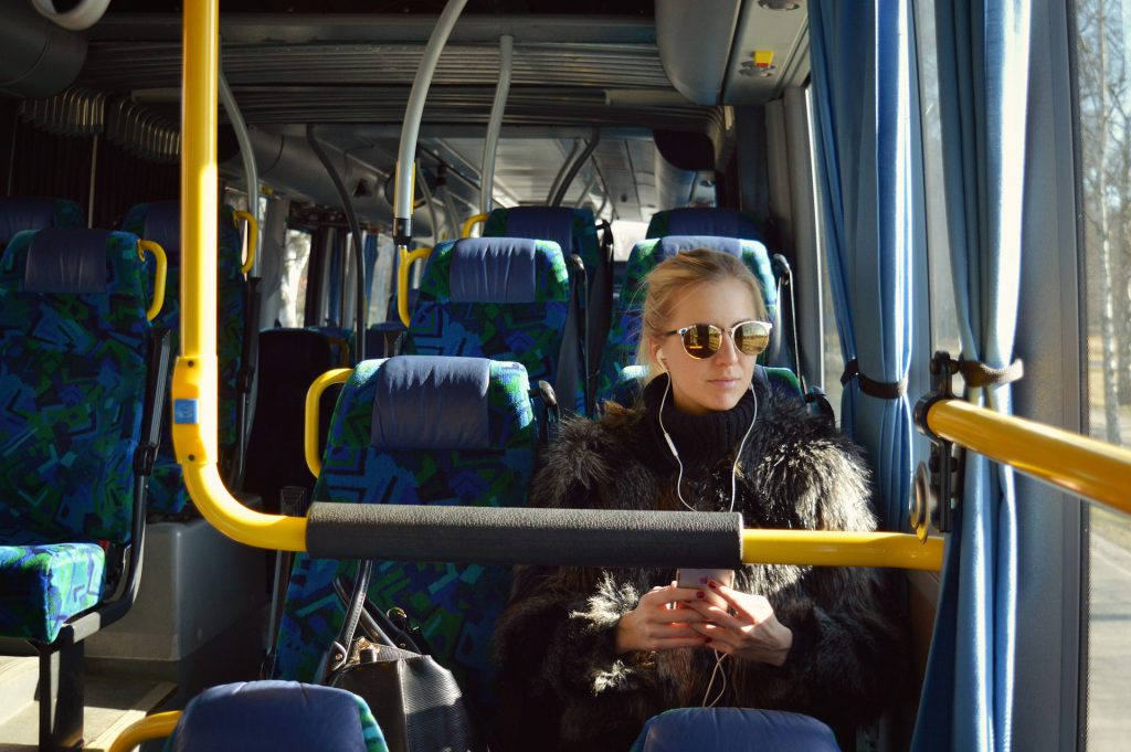 A passenger listening to music on the bus