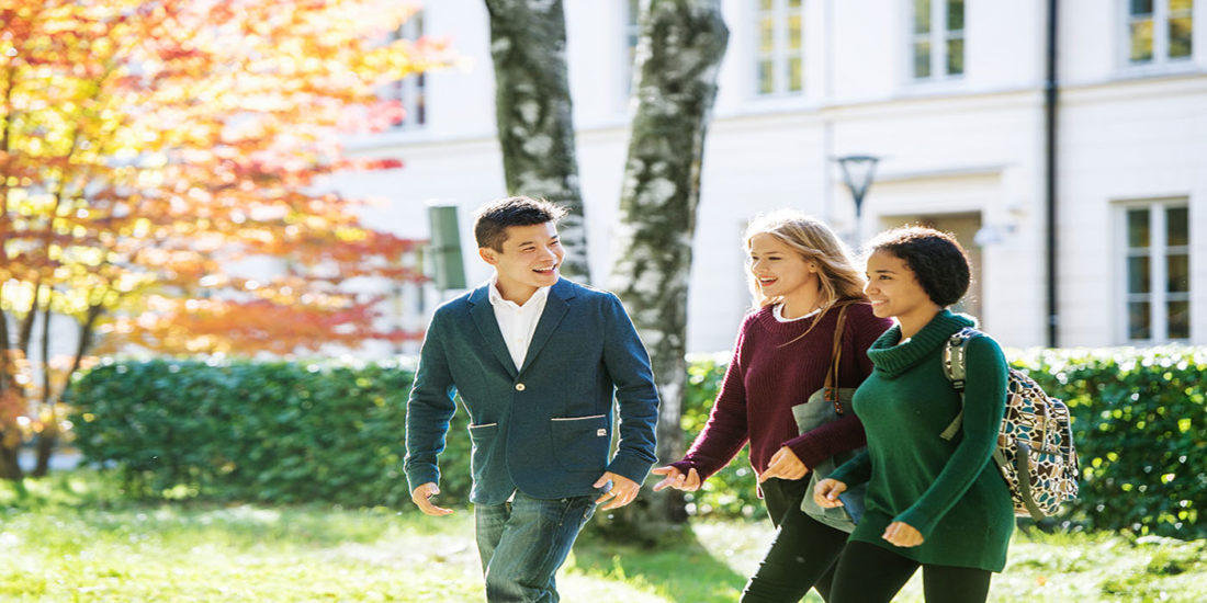 photo of students walking in park