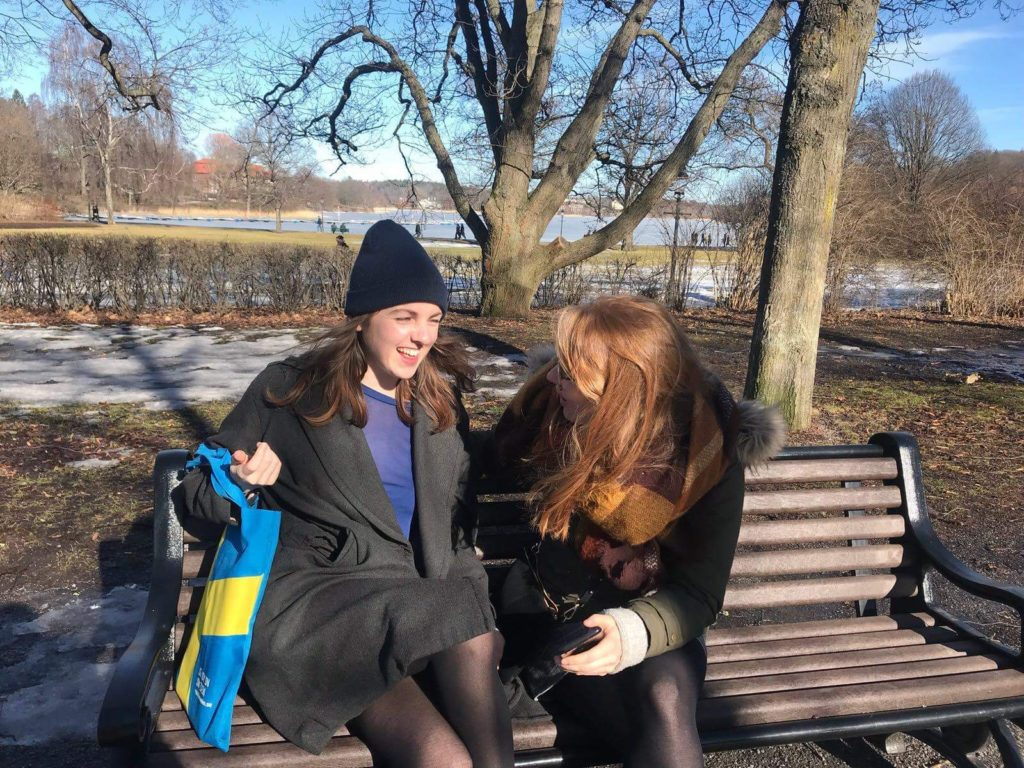 friends on a bench in the sun