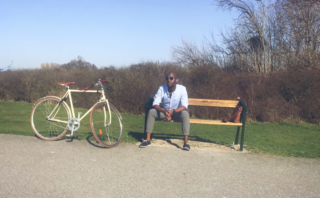 A photo of Sanjay relaxing with his bicycle