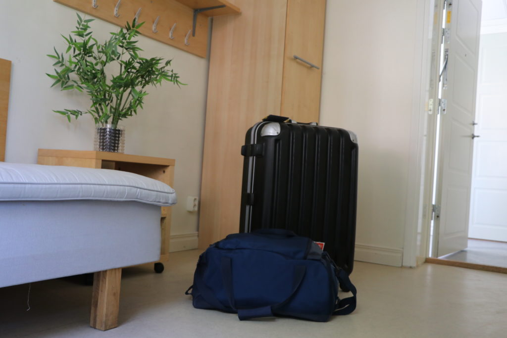 Photos of suitcases showing that travelling light can make things easier on arrival day