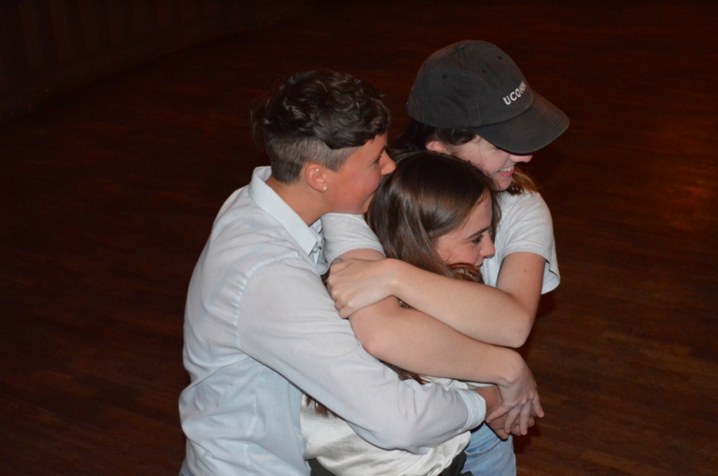 Three actors hugging!