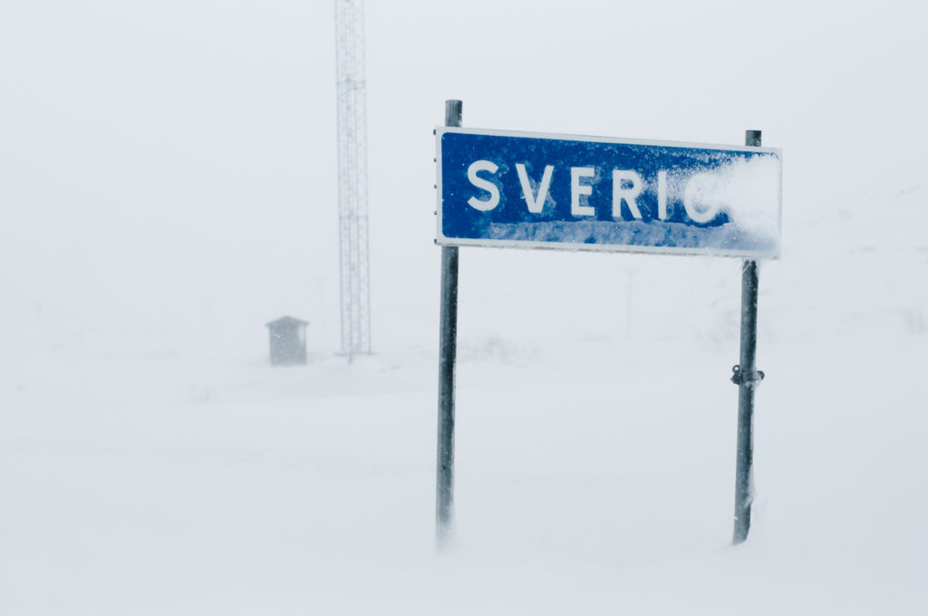 snowy Sweden sign at the border