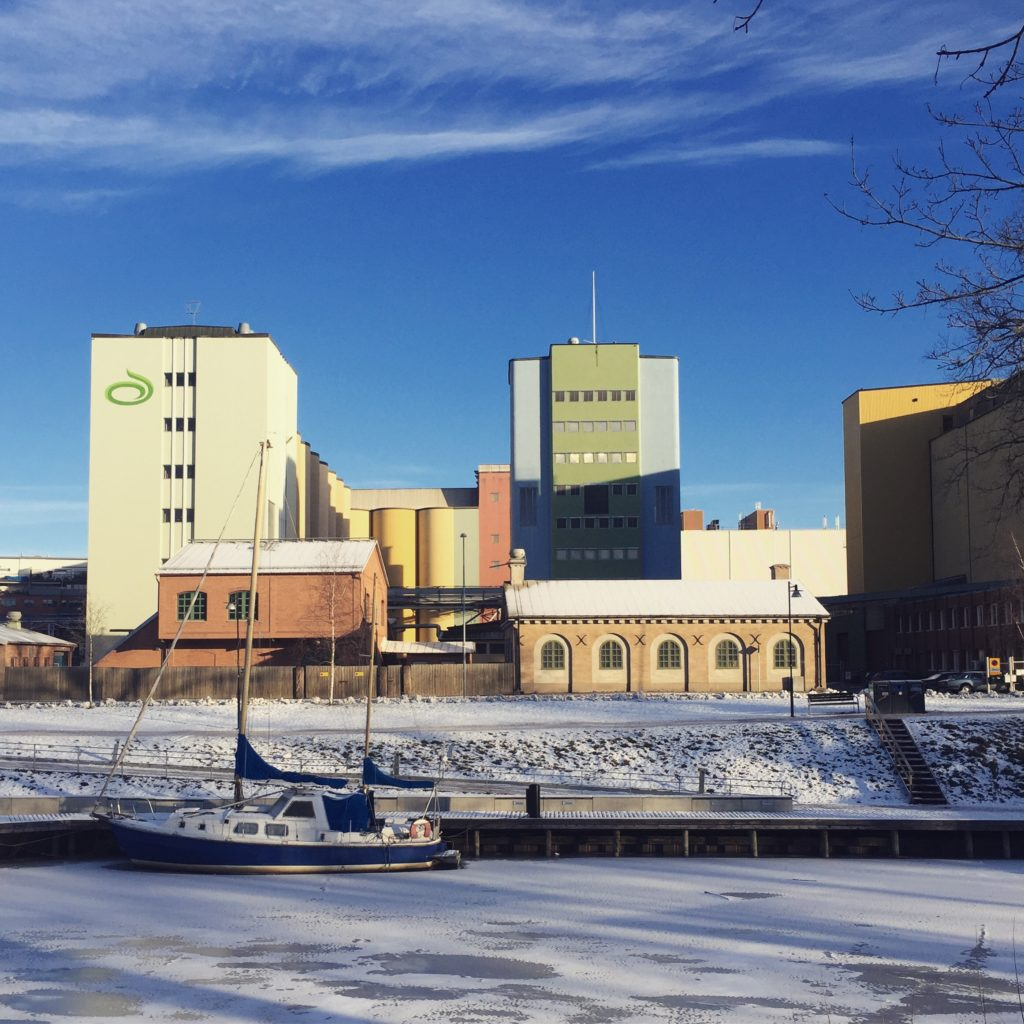 Frozen river and industrial buildings in Uppsala