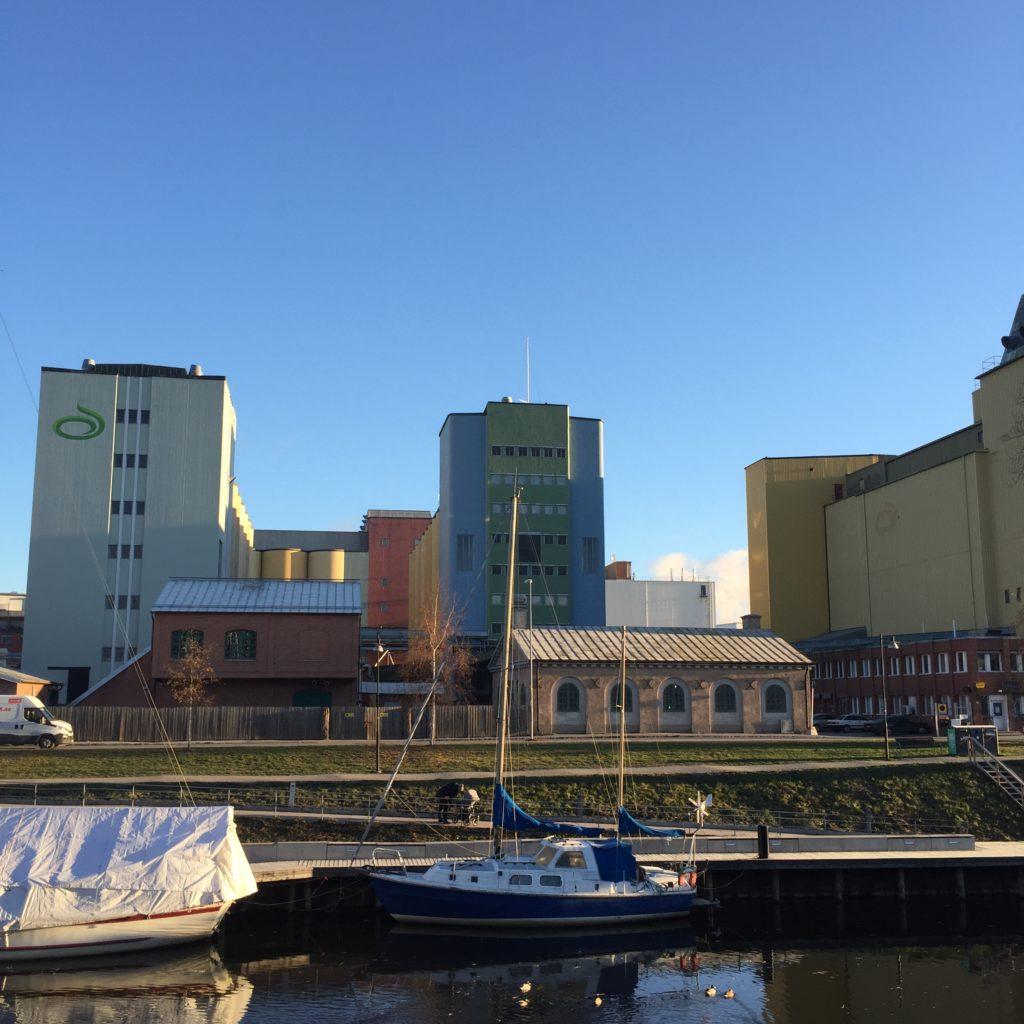Colourful industrial buildings alongside river in Uppsala