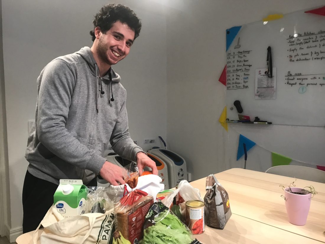 a smart student unpacks his groceries