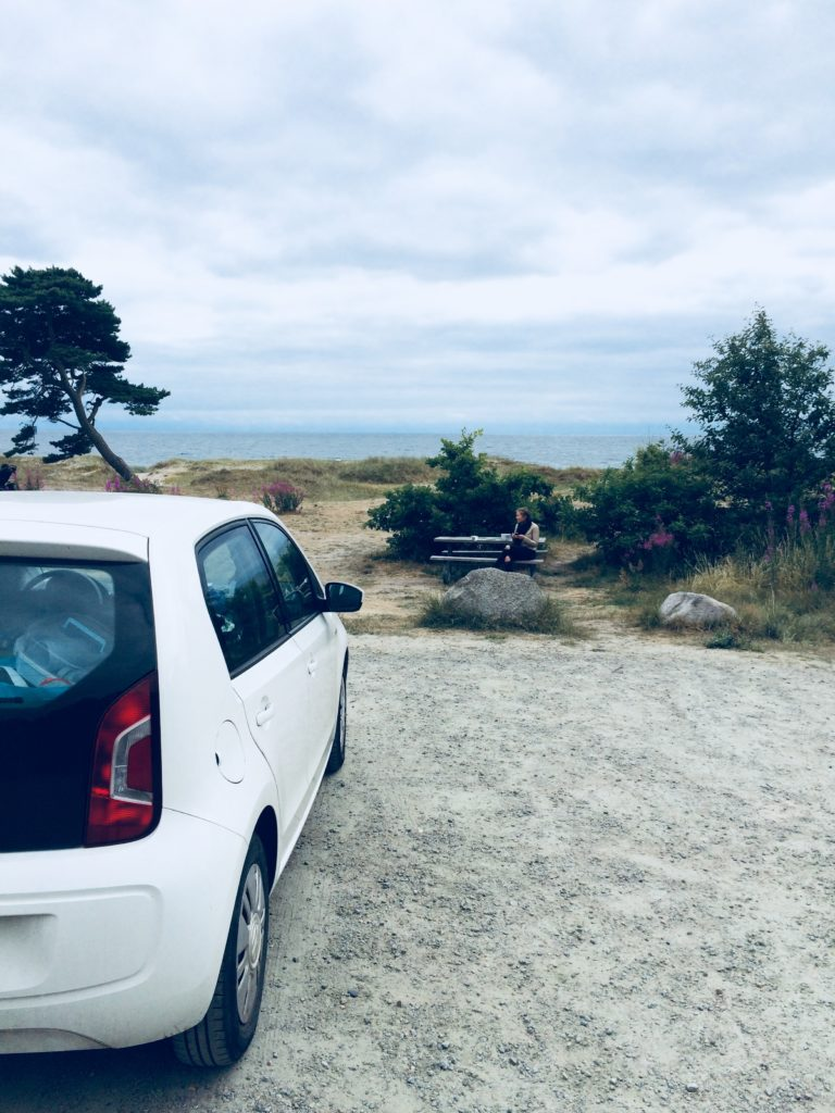 car and beach in Sweden
