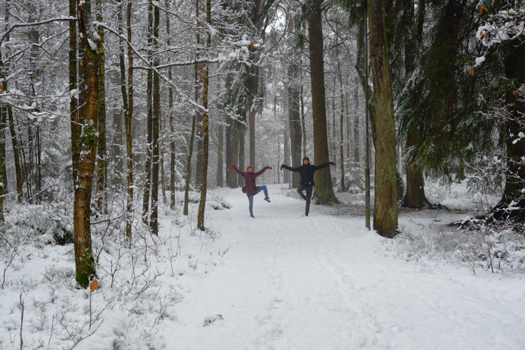 Two people dancing in the snowy forest