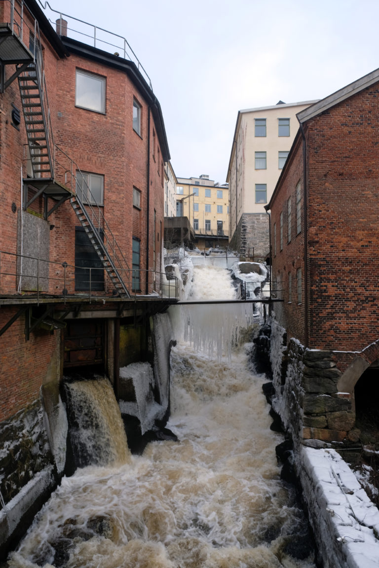 River flowing between old mill buildings in Mölndal near Gothenburg