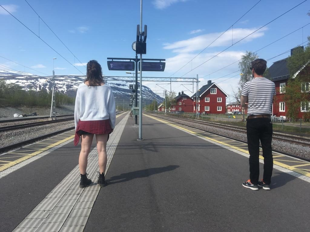 Friends waiting for a train in Abisko / Photo Credit: Nicolas