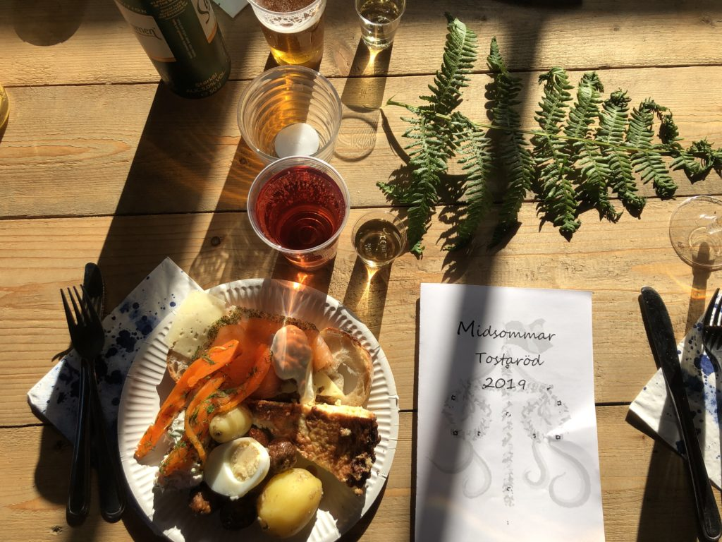 Midsommar food on a plate in the sun