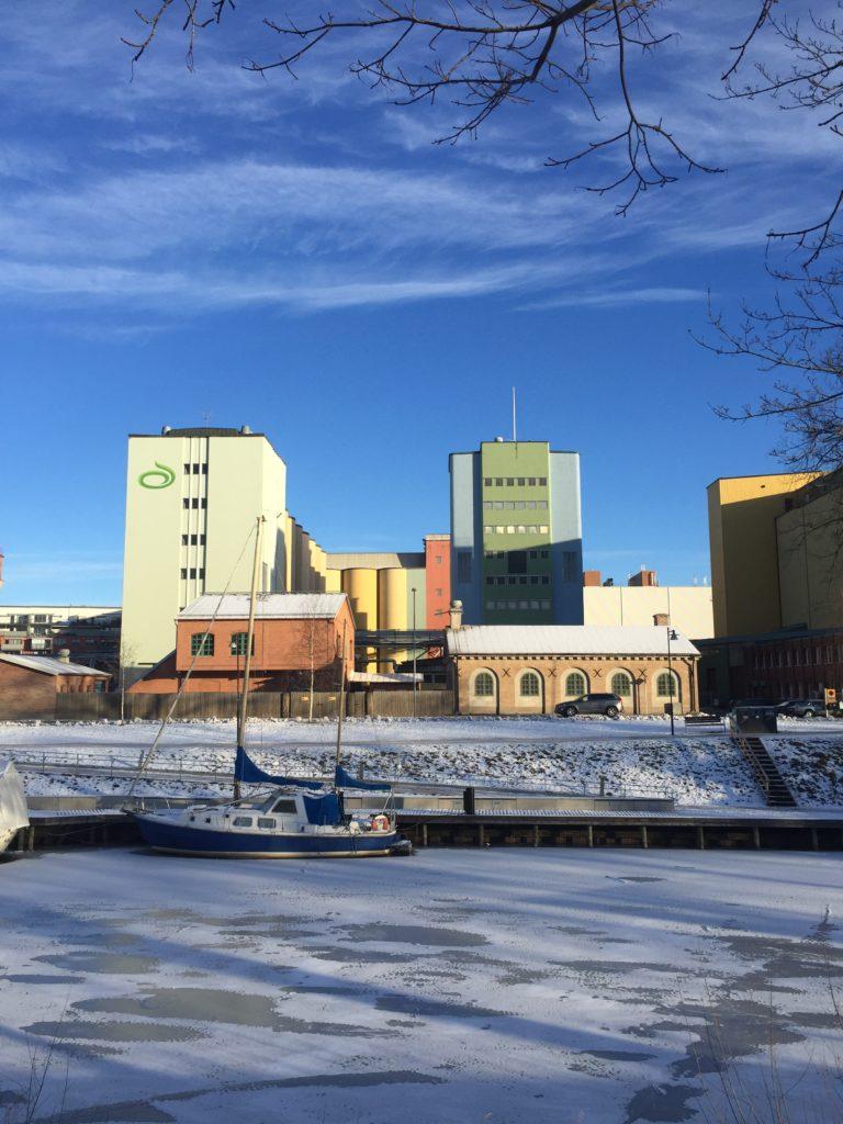 Industrial buildings and frozen river in Uppsala