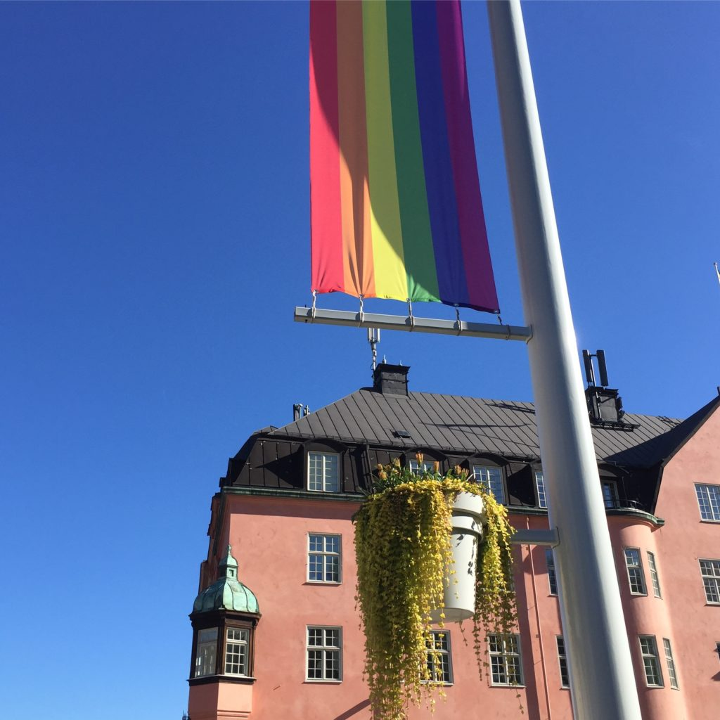 Pride flag and pink building in Uppsala