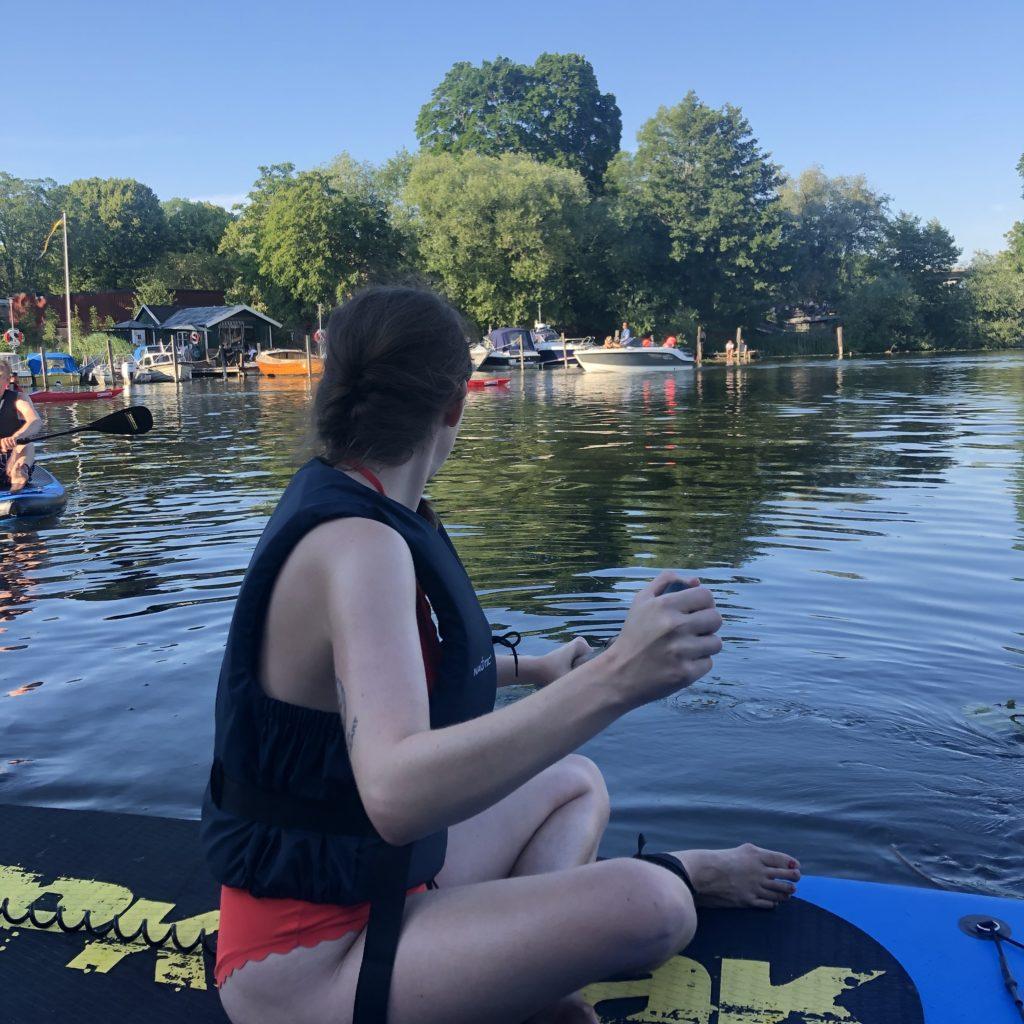 Me paddleboarding in Stockholm