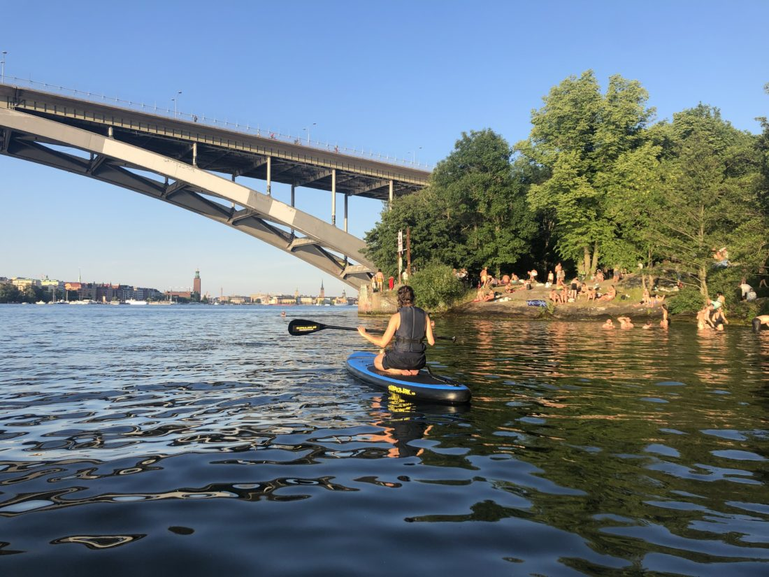 My friend paddleboarding around Långholmen, Stockholm