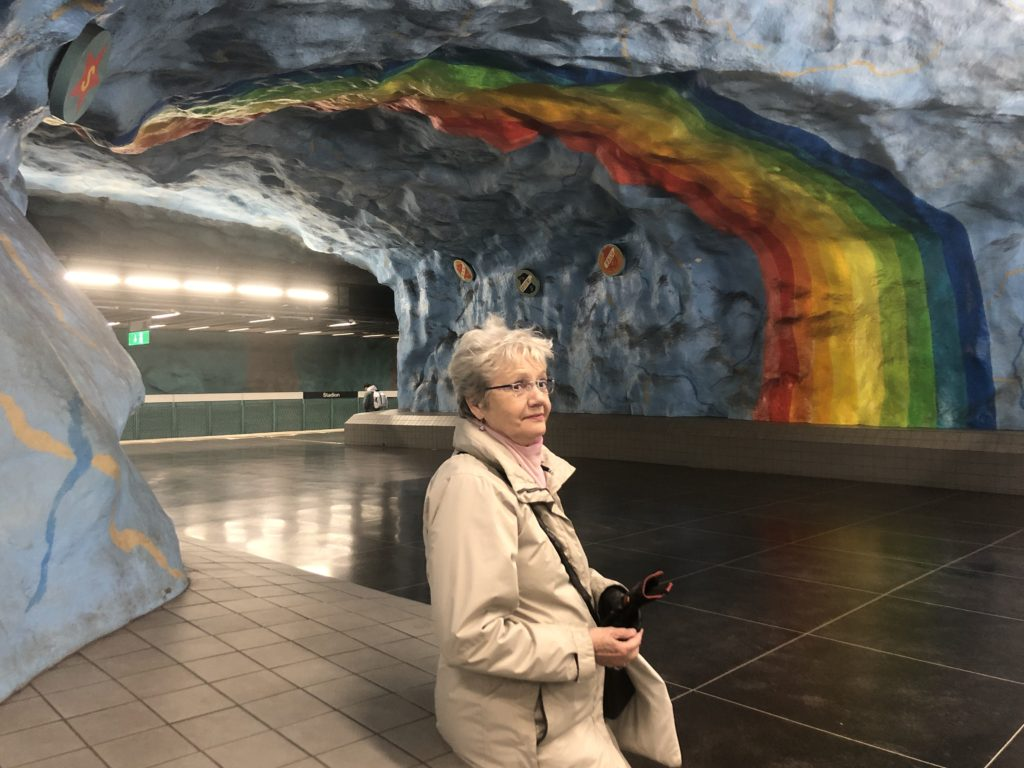 tour guide in stockholm metro station stadion
