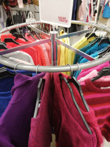 Rack of sweaters at Emmaus Borås