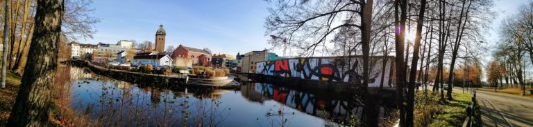 Panoramic view of Borås cityscape with colourful abstract mural by JM Rizzi