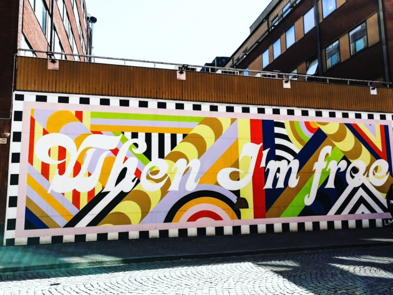 """Boldly coloured mural with text """"When I'm free"""""""