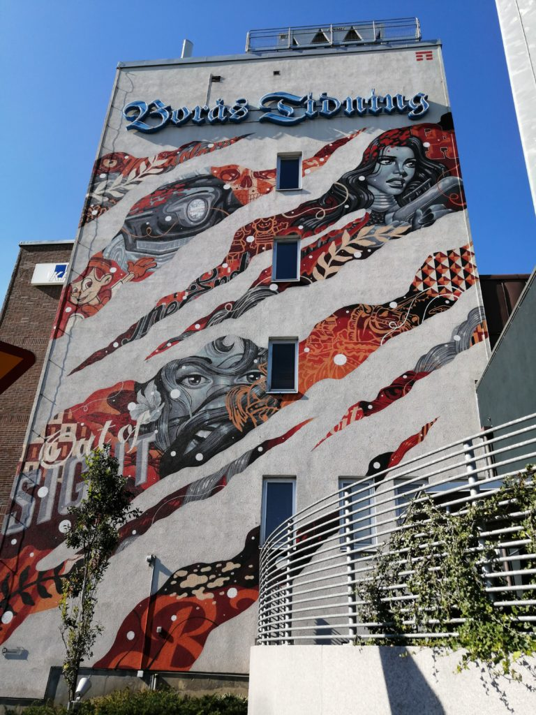 Graphic comic book inspired mural outside Borås newspaper office