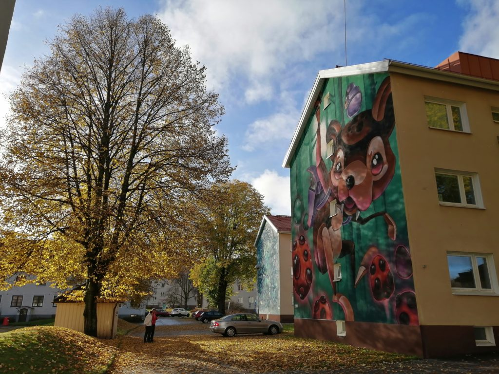 Mural in golden autumn landscape in Norrby suburb