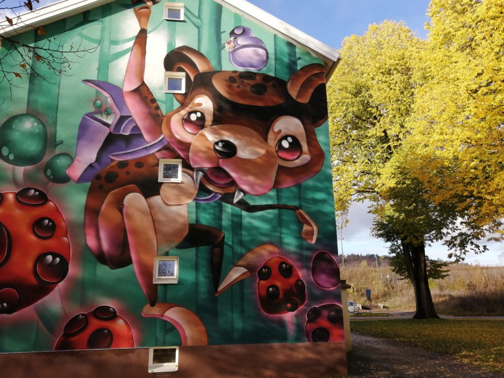 Colourful mural of cute and playful animalistic creature