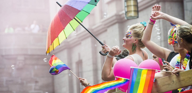 Person touts rainbow umbrella at Pride Festival in Stockholm